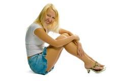 Blondes Mädchen auf weißem Hintergrund lizenzfreie stockbilder