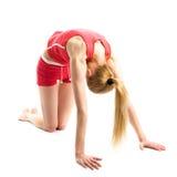 Blondes Mädchen, das gymnastische Übungen tut Lizenzfreie Stockfotografie