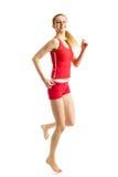 Blondes Mädchen, das gymnastische Übungen tut Stockbilder