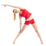 Blondes Mädchen, das gymnastische Übungen tut Stockfoto
