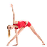 Blondes Mädchen, das gymnastische Übungen tut Stockfotos