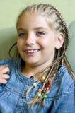 Blondes Mädchen in den Flechten lizenzfreies stockfoto