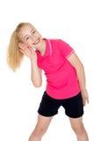 Blondes Mädchen der Nahaufnahme in der roten Strickjacke und im Kurzschluss Lizenzfreie Stockfotografie