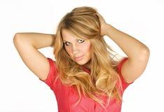 Blondes Mädchen der Schönheit im roten Kleid Stockfotos