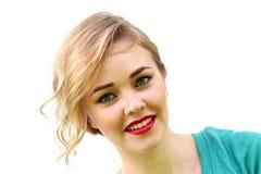 Blondes Mädchen des Lächelns Lizenzfreies Stockfoto