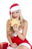 Blondes Mädchen gekleidet als Santa Claus Lizenzfreie Stockbilder