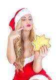 Blondes Mädchen gekleidet als Santa Claus Stockfotos