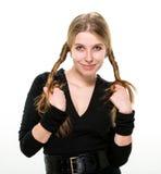 Blondes Mädchen hält ihr Haar Stockbilder