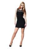 Blondes Mädchen im schwarzen Kleid Lizenzfreie Stockbilder