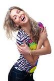 Blondes Mädchen im T-Shirt und in den Jeans Stockfotografie