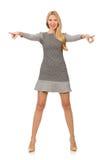 Blondes Mädchen im Tupfenkleid lokalisiert auf Weiß Stockfoto