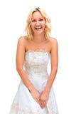 Blondes Mädchen lacht nett in einem Hochzeitskleid Lizenzfreies Stockfoto