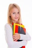 Blondes Mädchen mit Übungsbüchern Lizenzfreie Stockfotografie
