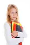 Blondes Mädchen mit Übungsbüchern Stockfotografie