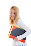 Blondes Mädchen mit Übungsbüchern Lizenzfreie Stockfotos