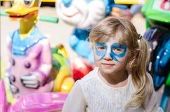 Blondes Mädchen mit dem Facepainting Lizenzfreie Stockbilder