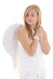 Blondes Mädchen mit dem Flügelträumen Stockfoto