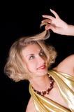 Blondes Mädchen mit dem Rotationhaar Stockfotos
