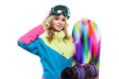 Blondes Mädchen mit dem Snowboard lokalisiert Stockbild