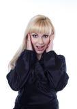 blondes Mädchen mit entsetztem Ausdruck Stockbild