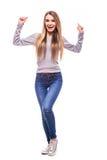 Blondes Mädchen mit Gewinngefühlen auf weißem Hintergrund Stockfoto