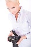 Blondes Mädchen mit Kamera Stockfotografie