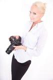 Blondes Mädchen mit Kamera Stockfoto