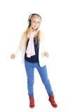 Blondes Mädchen mit Kopfhörer. Hören Musik und Tanzen. Lizenzfreie Stockbilder