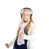 Blondes Mädchen mit Kopfhörer. Hören Musik und Tanzen. Stockbilder