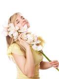 Blondes Mädchen mit Orchidee Stockfotografie