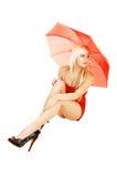 Blondes Mädchen mit Regenschirm. Stockfotografie