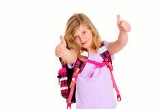 Blondes Mädchen mit Schultasche und den Daumen oben Stockfotografie