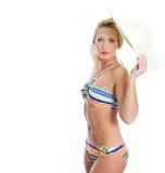 Blondes Mädchen mit Strohhut Stockfoto