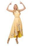 Blondes Mädchen in reizend Kleid mit Blume druckt Stockfoto