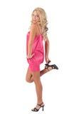 Blondes Mädchen, das auf einem Fuß steht Stockfotos