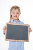 Blondes Schulmädchen auf weißem Hintergrund Lizenzfreie Stockfotografie