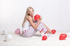 Blondevrouw met ballons Royalty-vrije Stock Afbeelding