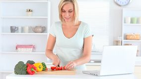 Blondhaired woman cooking stock video footage