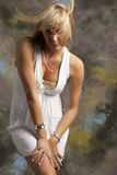 Blondie. Beautiful blonde woman in white dress Stock Photos