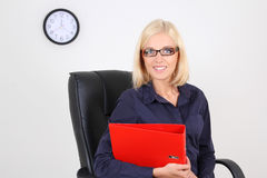 Blondie businesswoman with folders Stock Photo