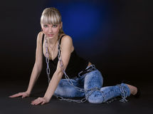 Blondie in chains over black background Royalty Free Stock Photos