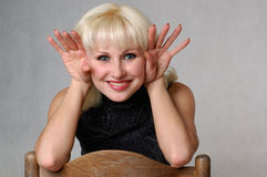 Blondie and a chair Stock Photography