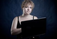 Blondie with computer Royalty Free Stock Image