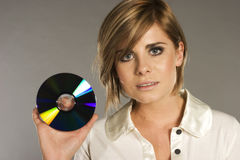 Blondie con CD Fotografía de archivo
