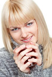Blondie with cup of tea. Over white Royalty Free Stock Images