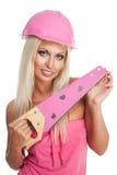 Blondie Frau mit rosafarbenem Hilfsmittel Lizenzfreies Stockbild