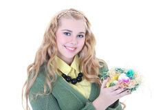 Blondie girl with easter eggs in the nest Royalty Free Stock Images
