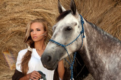 Blondie girl and horse Stock Photos