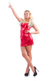 Blondie im Rotfunkelnden Minikleid an lokalisiert Stockfotografie
