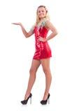 Blondie im Rotfunkelnden Minikleid an lokalisiert Stockbilder